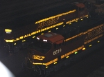 BNSF 6619 and BNSF 6620 light up their new logo swoosh paint jobs in front of the Locomotive works.